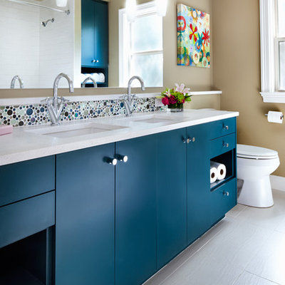 Bathroom - contemporary kids' mosaic tile and multicolored tile bathroom idea in Austin with blue cabinets, an undermount sink, flat-panel cabinets, quartz countertops and beige walls