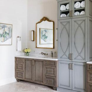 Example of a tuscan limestone floor, double-sink and coffered ceiling bathroom design in Phoenix with recessed-panel cabinets, blue cabinets, marble countertops, a hinged shower door and a built-in vanity