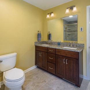 Immagine di una stanza da bagno con doccia chic di medie dimensioni con ante in legno bruno, pistrelle in bianco e nero, pareti gialle, pavimento in pietra calcarea e top in granito