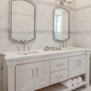 Example of a transitional gray floor bathroom design in Other with shaker cabinets, white cabinets, gray walls, an undermount sink and white countertops