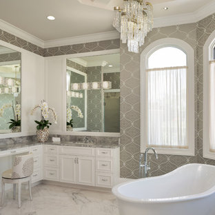 Bathroom - large mediterranean master marble floor and white floor bathroom idea in Miami with quartzite countertops, gray countertops, recessed-panel cabinets, white cabinets, multicolored walls and an undermount sink