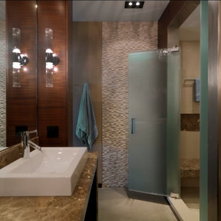 Example of a mountain style mosaic tile bathroom design in Burlington with a vessel sink