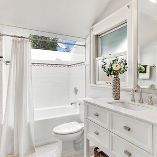 Example of a large arts and crafts master white tile and ceramic tile ceramic tile and white floor bathroom design in Seattle with white cabinets, white countertops, furniture-like cabinets, a two-piece toilet, gray walls and an undermount sink