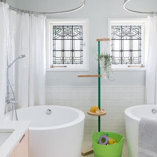 Transitional kids' beige floor freestanding bathtub photo in Seattle with flat-panel cabinets, light wood cabinets, gray walls, an undermount sink and white countertops
