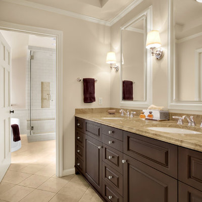 Bathroom - traditional bathroom idea in Seattle with solid surface countertops and an undermount sink