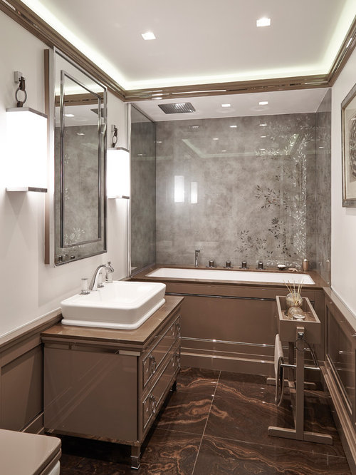 example of a small trendy master tubshower combo design in london with a vessel