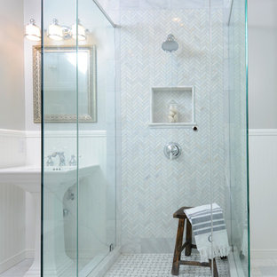 Example of a classic stone tile bathroom design in Los Angeles with a pedestal sink
