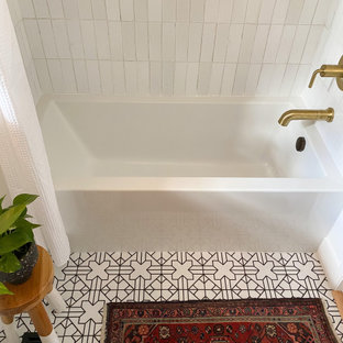 This is an example of a mid-sized eclectic master bathroom in Portland with dark wood cabinets, an alcove tub, a shower/bathtub combo, white tile, ceramic tile, white walls, ceramic floors, white floor, a shower curtain, white benchtops, a niche and a single vanity.