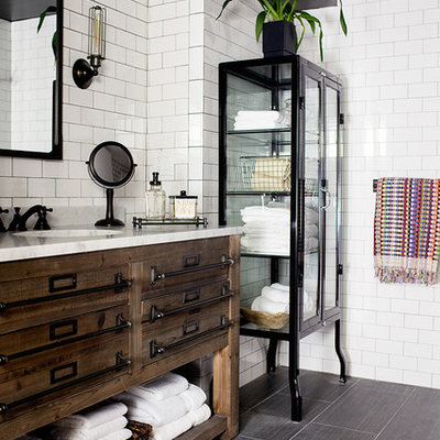 Transitional white tile and subway tile ceramic tile bathroom photo in New York with an undermount sink, marble countertops, black walls and flat-panel cabinets
