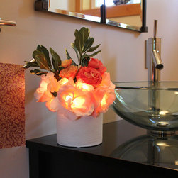 The Firefly Garden - Radiant Roses - Pink/Peach in White Ceramic Vase - Bring the timeless beauty of Roses to your home, with the added feature of lighting. Housed in a selection of vases, Radiant Roses is perfect for a guest bedroom or bathroom. This battery operated floral arrangement is a unique alternative to a night light .The glowing Roses cast subtle and beautiful shadows to accent any space.