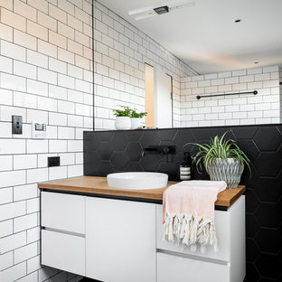 Inspiration for a scandinavian bathroom in Perth with flat-panel cabinets, white cabinets, white walls and black floor.