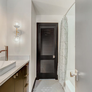 This is an example of a medium sized contemporary family bathroom in Dallas with flat-panel cabinets, green cabinets, an alcove bath, a one-piece toilet, white tiles, ceramic tiles, white walls, ceramic flooring, a vessel sink, quartz worktops and grey floors.