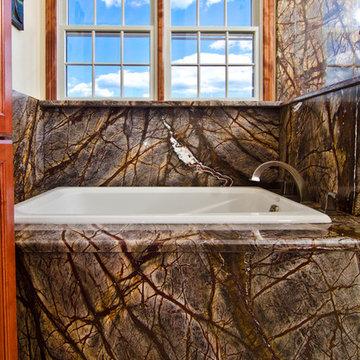 Rainforest Brown Granite vanity, tub surround, and shower wall