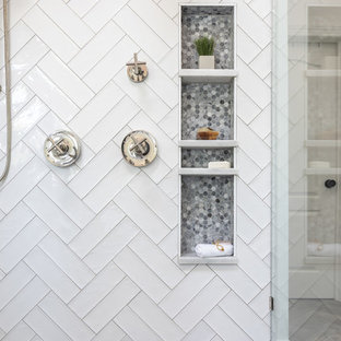 Inspiration for a mid-sized cottage master white tile and ceramic tile porcelain tile and brown floor bathroom remodel in Raleigh with recessed-panel cabinets, white cabinets, a two-piece toilet, white walls, an undermount sink, marble countertops, a hinged shower door and white countertops