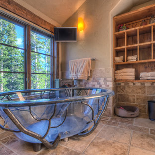 Mountain style master beige tile freestanding bathtub photo in Denver with open cabinets, medium tone wood cabinets and beige walls