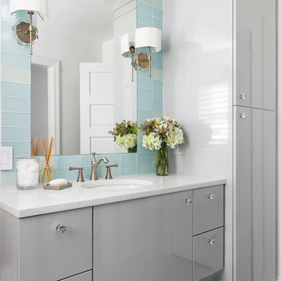 Example of a mid-sized transitional glass tile and blue tile multicolored floor bathroom design in St Louis with flat-panel cabinets, gray cabinets, an undermount sink and white countertops