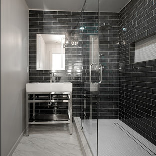Inspiration for a small modern kids' black tile and ceramic tile marble floor and gray floor corner shower remodel in Other with furniture-like cabinets, a two-piece toilet, gray walls, a console sink and a hinged shower door
