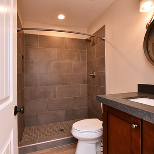 Mid-sized farmhouse 3/4 gray tile and porcelain tile light wood floor and brown floor bathroom photo in Phoenix with shaker cabinets, dark wood cabinets, a two-piece toilet, beige walls, an undermount sink and zinc countertops