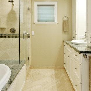 Esempio di una stanza da bagno padronale chic di medie dimensioni con lavabo da incasso, ante con riquadro incassato, ante bianche, top in granito, vasca da incasso, doccia ad angolo, piastrelle bianche, piastrelle in pietra, pareti beige e pavimento in travertino