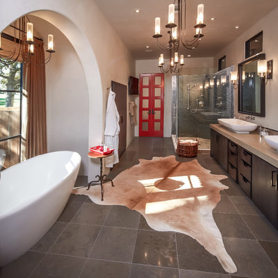 Bathroom - mid-sized eclectic master gray tile and mosaic tile gray floor and ceramic tile bathroom idea in Houston with a trough sink, flat-panel cabinets, dark wood cabinets, white walls, quartz countertops and a hinged shower door