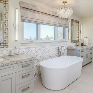 Tuscan master multicolored tile beige floor freestanding bathtub photo in San Francisco with shaker cabinets, beige cabinets, beige walls, an undermount sink, beige countertops and granite countertops