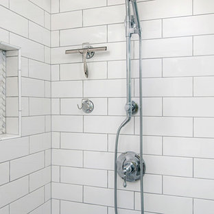 Example of a mid-sized minimalist master white tile and subway tile porcelain floor and gray floor bathroom design in San Diego with recessed-panel cabinets, white cabinets, a two-piece toilet, white walls, a drop-in sink, quartzite countertops and white countertops
