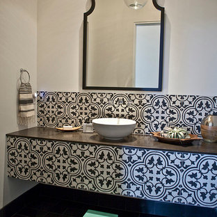 Example of a mid-sized tuscan 3/4 black and white tile and cement tile slate floor bathroom design in San Diego with a one-piece toilet, white walls, a vessel sink and granite countertops