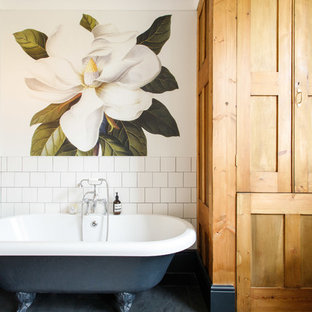 Medium sized traditional family bathroom in Kent with medium wood cabinets, a claw-foot bath, white tiles, ceramic tiles, slate flooring and black floors.