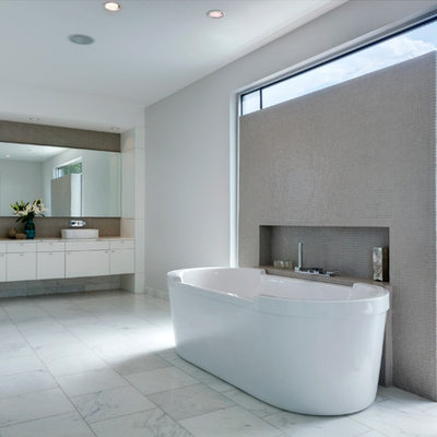 Trendy mosaic tile freestanding bathtub photo in Dallas with a vessel sink