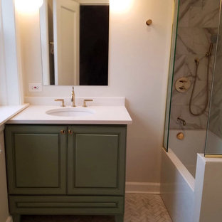 Inspiration for a mid-sized modern master white tile and porcelain tile porcelain tile and white floor bathroom remodel in Chicago with raised-panel cabinets, green cabinets, a two-piece toilet, beige walls, an undermount sink, quartz countertops and white countertops