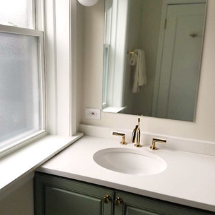 Mid-sized minimalist master white tile and porcelain tile porcelain tile and white floor bathroom photo in Chicago with raised-panel cabinets, green cabinets, a two-piece toilet, beige walls, an undermount sink, quartz countertops and white countertops