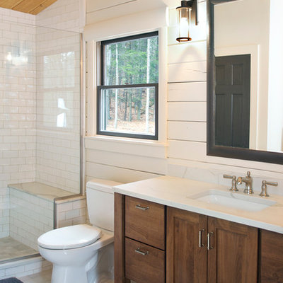Large cottage master white tile and subway tile porcelain tile and gray floor alcove shower photo in New York with shaker cabinets, dark wood cabinets, a two-piece toilet, white walls, an undermount sink, quartz countertops, a hinged shower door and white countertops