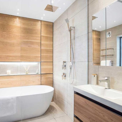 Inspiration for a mid-sized scandinavian kids' brown tile and wood-look tile ceramic tile, gray floor and single-sink bathroom remodel in London with flat-panel cabinets, light wood cabinets, a one-piece toilet, gray walls, a console sink, solid surface countertops, white countertops and a freestanding vanity