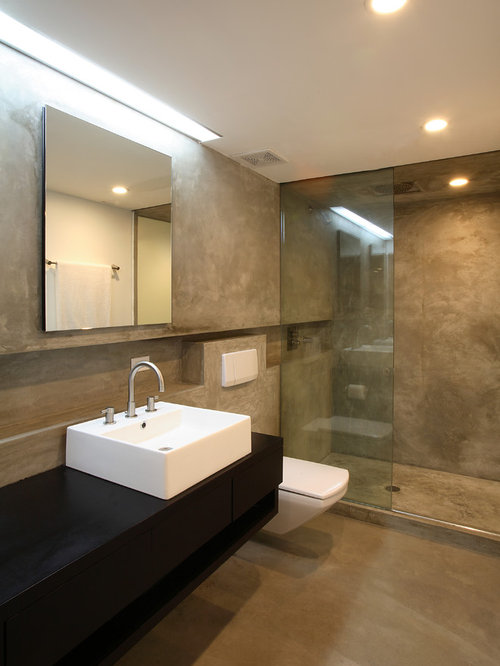 example of a trendy concrete floor bathroom design in new york with a vessel sink - Bathroom Designs Vessel Sinks