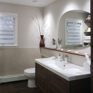Inspiration for a small transitional kids' beige tile and porcelain tile porcelain floor and brown floor alcove bathtub remodel in New York with shaker cabinets, medium tone wood cabinets, a one-piece toilet, beige walls, an integrated sink and solid surface countertops