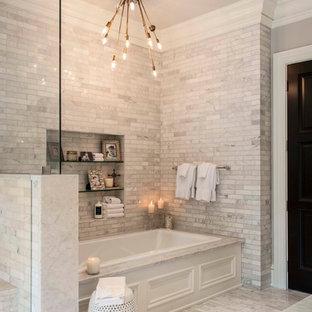 На фото: главная ванная комната в стиле современная классика с серыми стенами, мраморной столешницей, накладной ванной и серой плиткой с