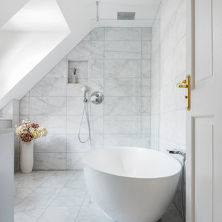 This is an example of a medium sized contemporary bathroom in Cambridgeshire with a freestanding bath, marble tiles, grey walls, marble flooring, white floors, an open shower and grey tiles.