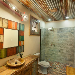 Design ideas for a country bathroom in Dallas with a curbless shower, wood benchtops and brick floors.