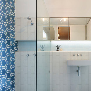Design ideas for a small contemporary master bathroom in Brisbane with glass-front cabinets, blue tile, ceramic tile, white walls, cement tiles, blue floor, an alcove shower, an open shower, white benchtops and a wall-mount sink.