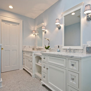 Inspiration for a large transitional master bathroom in New York with recessed-panel cabinets, white cabinets, blue walls, marble floors, an undermount sink and marble benchtops.