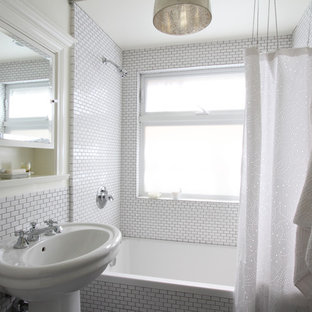 Transitional alcove bathtub photo in Los Angeles with a pedestal sink