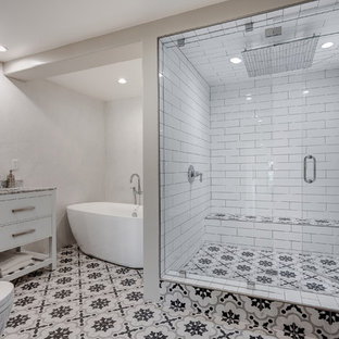 Example of a large tuscan master white tile and subway tile multicolored floor and cement tile floor bathroom design in Los Angeles with flat-panel cabinets, a one-piece toilet, white walls, an integrated sink, marble countertops, white cabinets and a hinged shower door