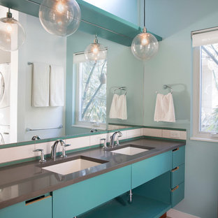 Bathroom - contemporary bathroom idea in Austin with flat-panel cabinets, blue cabinets and gray countertops