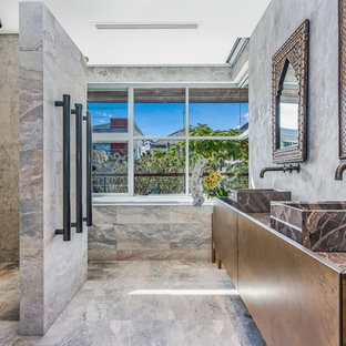 Design ideas for an asian master bathroom in Perth with a curbless shower, beige tile, gray tile, grey walls, a vessel sink, beige floor, an open shower and brown benchtops.