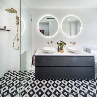 Photo of a contemporary master bathroom in Sydney with a one-piece toilet, white tile, ceramic tile, white walls, cement tiles, an open shower, white benchtops, flat-panel cabinets, black cabinets, a curbless shower, a vessel sink and multi-coloured floor.