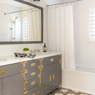Bathroom - mid-sized transitional kids' white tile and ceramic tile ceramic tile and multicolored floor bathroom idea in San Francisco with gray cabinets, an undermount sink, quartzite countertops, white countertops, flat-panel cabinets and white walls