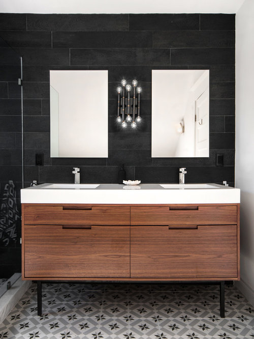 Inspiration for a transitional black tile bathroom remodel in Toronto with black walls