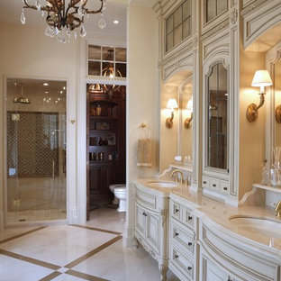 Design ideas for a victorian bathroom in Burlington with an alcove shower, raised-panel cabinets and beige floor.