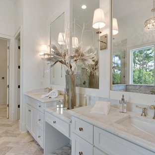 Inspiration for a large coastal master gray tile, white tile and stone slab marble floor bathroom remodel in Miami with recessed-panel cabinets, white cabinets, white walls, an undermount sink and marble countertops