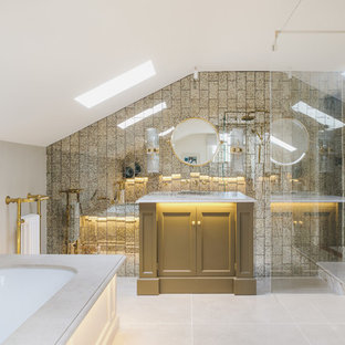 Medium sized modern ensuite bathroom in Other with freestanding cabinets, a submerged bath, a built-in shower, metal tiles, grey walls, beige floors and white worktops.
